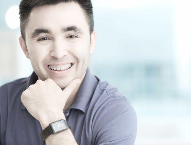 Man with braces smiling iSmile Orthodontics Redmond WA